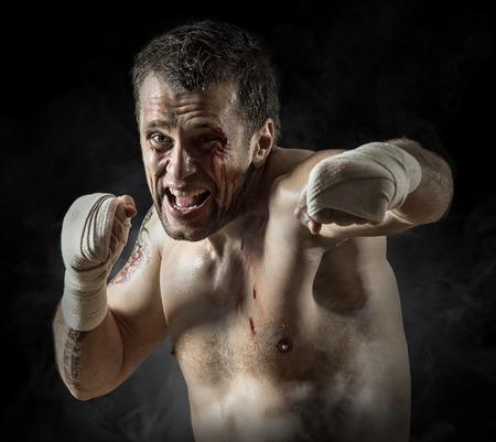 blood sport: Portrait of aggressiv boxer in blood