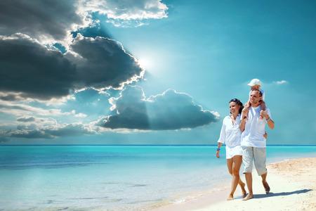 bikini island: View of happy young family having fun on the beach
