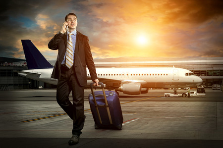 Businessman with baggage in airport photo