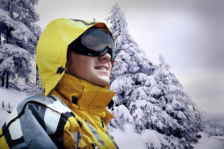 mounts: Portrait of man wearing a helmet and glasses on the background of snow winter and mounts. Stock Photo