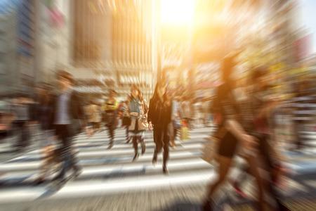 People in bokeh, street downtown view of  Tokyo. Standard-Bild
