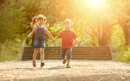 Happiness boy and girl fun outdoor under sunlight Reklamní fotografie
