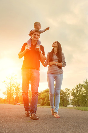 flare: Happiness family outdoor Stock Photo