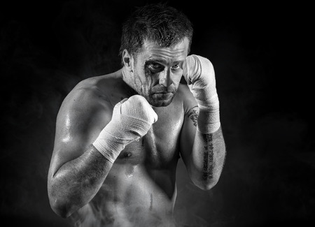 punched: Portrait of aggressiv boxer in blood