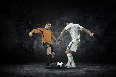 Splash of drops around football player under water Reklamní fotografie