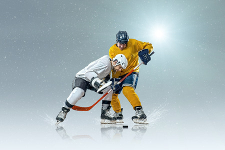 team sports: Ice hockey player on the ice and light effects