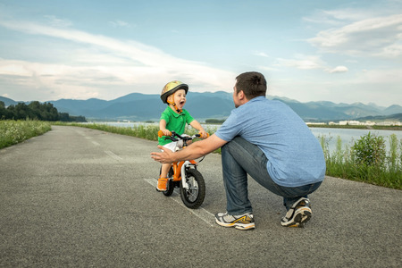 road cycling: Father and son on the bicycle outdoor
