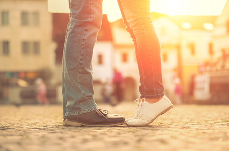 2 people: Couples foots stay at the street under sunlight Stock Photo
