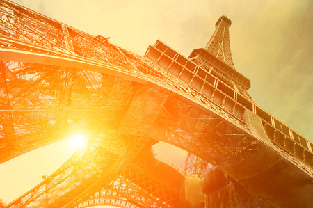 built tower: The Eiffel tower is one of the most recognizable landmarks in the world under sun light