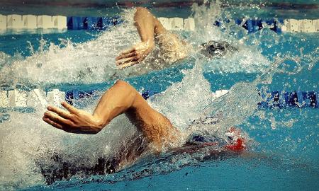 waterpool: Swimming in waterpool with blue wate Stock Photo