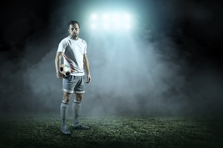 light game: Soccer player with ball in action outdoors