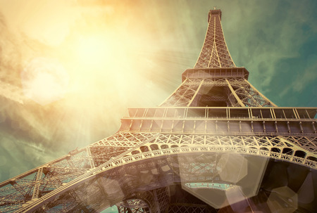 towers: The Eiffel tower is one of the most recognizable landmarks in the world under sun light