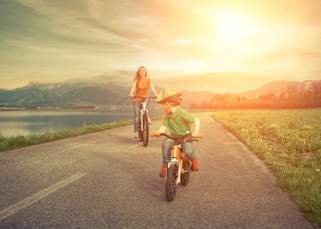 mother nature: Happiness Mother and son on the bicycles funning outdoor Stock Photo