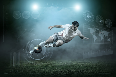 soccer goal: Soccer player with ball in action outdoors