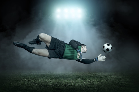 action: Soccer player with ball in action outdoors