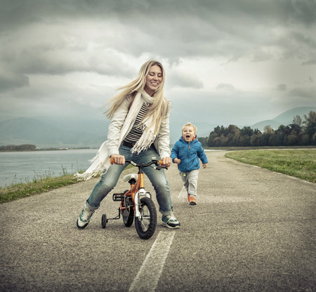 riding: Happiness Mother and son on the bicycle outdoor