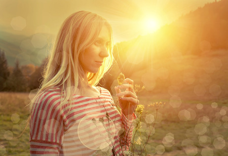one woman: Happiness woman stay outdoor under sunlight of sunset Stock Photo