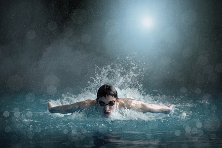 competitive: Swimmer in open waterpool, swim one of swimming style Stock Photo