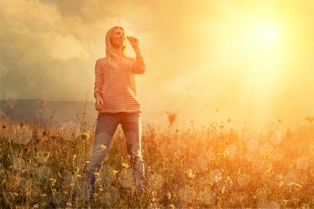 fun in the sun: Happiness woman stay outdoor under sunlight of sunset Stock Photo