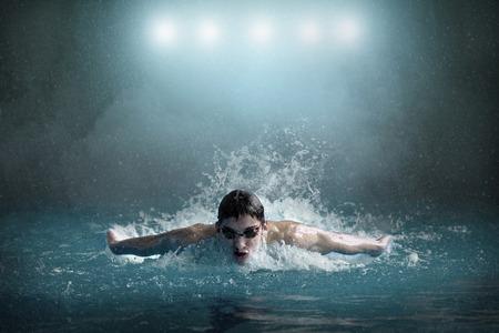 waterpool: Swimmer in waterpool. Butterfly style