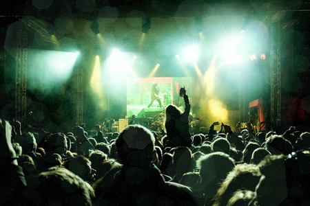 concert: Rock concert, silhouettes of happy people raising up hands