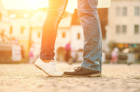 people walking: Couples foots stay at the street under sunlight Stock Photo