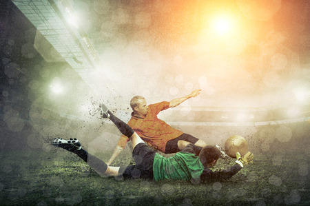 people in action: Soccer player with ball in action at stadium under rain.