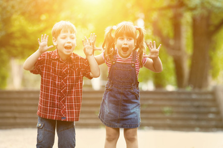 action girl: Happiness boy and girl fun outdoor under sunlight Stock Photo