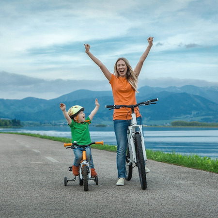 Happiness Mother and son on the bicycles funning outdoor Reklamní fotografie