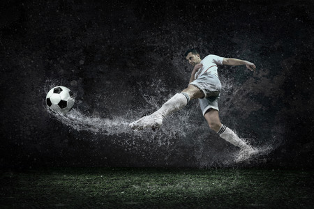 footballs: Splash of drops around football player under water Stock Photo