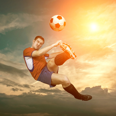 people in action: Football player with ball in action outdoors