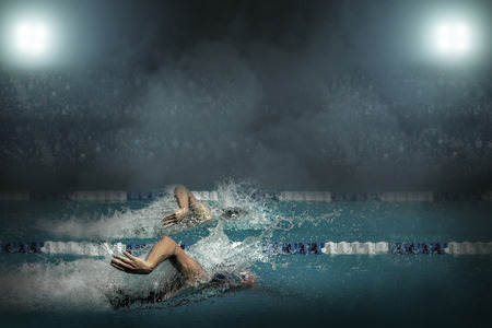 Swimmer in open waterpool
