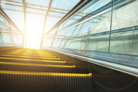 elevated walkway: Blurry modern escalator at sunny day.