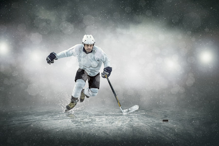 in action: Ice hockey player on the ice, outdoors