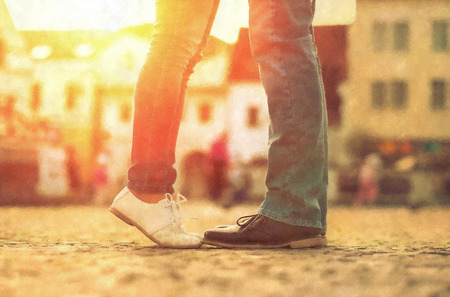 men s: Couples foots stay at the street under sunlight Stock Photo