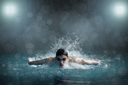 competition success: Swimming in waterpool Stock Photo