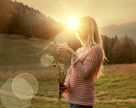 autumn colors: Happiness woman stay outdoor under sunlight of sunset Stock Photo