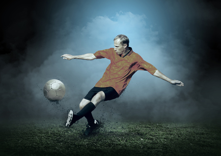 people in action: Soccer player with ball in action outdoors