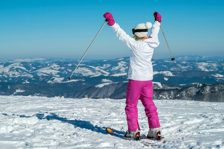 Female at ski stay on the top of mountain with beautiful view Stock Photo