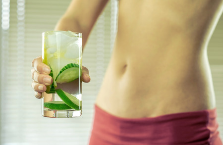 healthy sport: Healthy coctail in the hands of fitness female.
