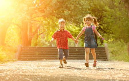 the nature of sunlight: Happiness boy and girl fun outdoor under sunlight Stock Photo