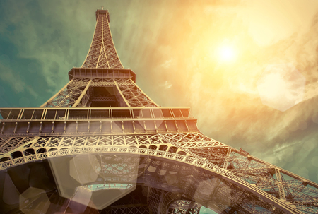 paris night: The Eiffel tower is one of the most recognizable landmarks in the world under sun light