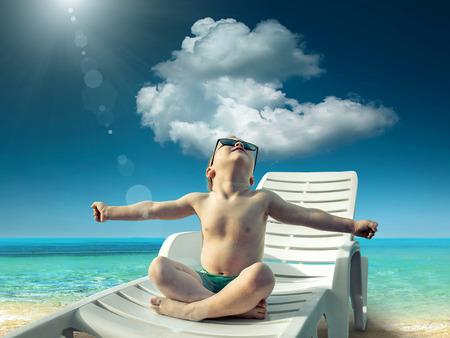 heat wave: Child in sunglasses fun near the water under sunlight