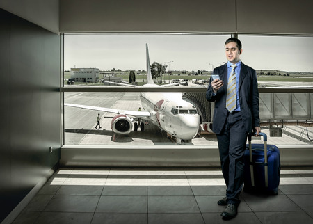 airport business: Businessman with baggage in airport Stock Photo
