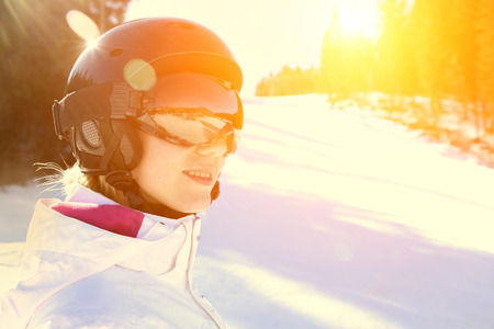 mounts: Woman wearing a helmet and glasses on the background of snow winter and mounts.