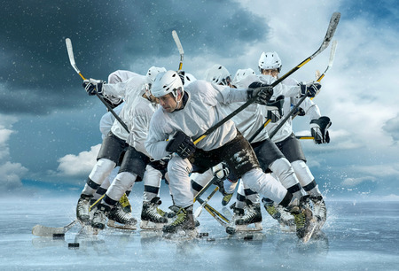 hockey puck: Ice hockey player in action outdoor around mountains