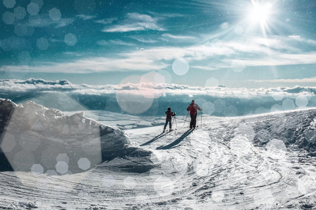 sport fitness: Two skiers on the peak of mountain in sunny day. Stock Photo