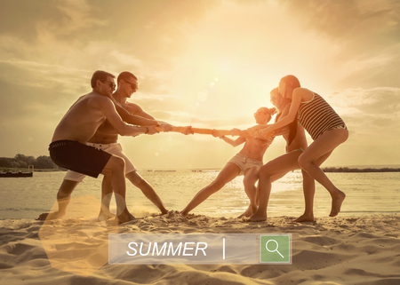 competitions: Friends funny tug of war on the beach under sunset sunlight.