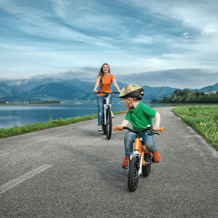 children learning: Happiness Mother and son on the bicycles funning outdoor Stock Photo