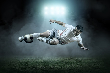 Soccer player with ball in action outdoors 免版税图像 - 48723054